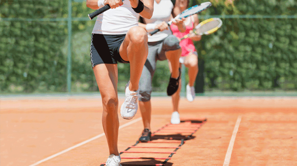 People training for tennis