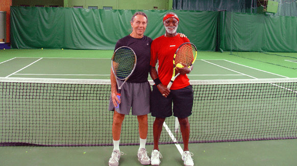 Two male friend playing tenins together in one of our tennis leagues. located inside at Vermont Sport and Fitness club