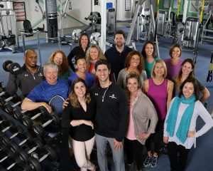 Group photo of all of the staff at Vermont Sport & Fitness club. This photo was taking in the weight room centeraly located in the gym.
