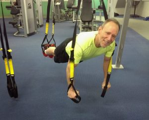 Tracy working out on the TRX at Vermont Sport Fitness Club