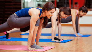 Yoga class on mats. These women represent a class at Vermont Sport and Fitness club