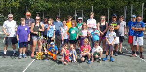 Group of 20 kids at tennis camp at Vermont Sport & Fitness. Junior tennis camp played on outdoor hard true tennis courts