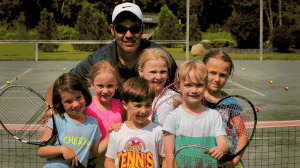 Tennis Pro Paco with Campers at Tennis camp